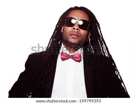 businessman wearing sunglasses and suit dreadlocks - stock photo