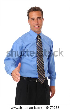 Businessman welcoming with extended hand against a white background - stock photo