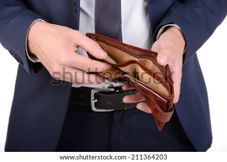 Businessman well-dressed with empty wallet, no money - stock photo