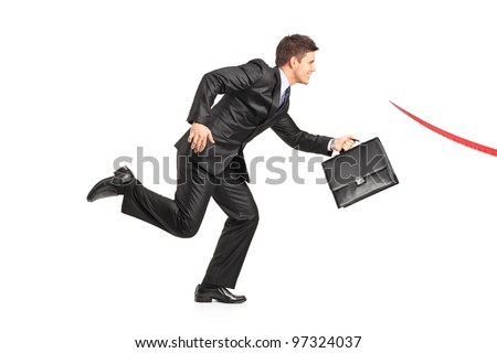 Businessman with a briefcase running towards a finish line isolated on white background - stock photo