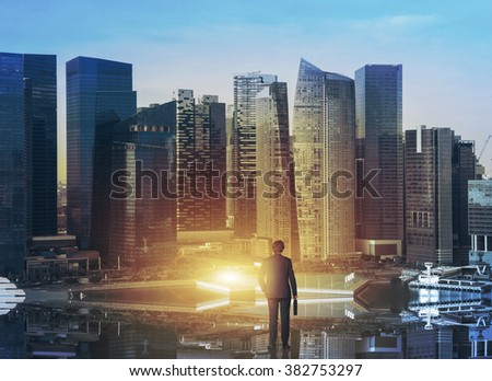 businessman with a case having just arrived to Singapore. City in the sunrise. Back view. Concept of a new start. - stock photo