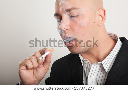 Businessman with a cigarette - stock photo