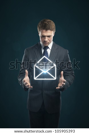 Businessman with a envelope on his hands - stock photo