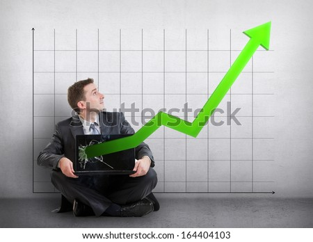 Businessman with a graph showing growth  - stock photo