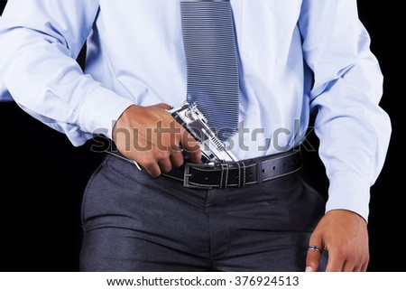 Businessman with a handgun - stock photo