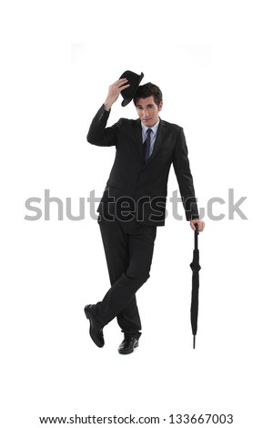 Businessman with a hat and umbrella - stock photo