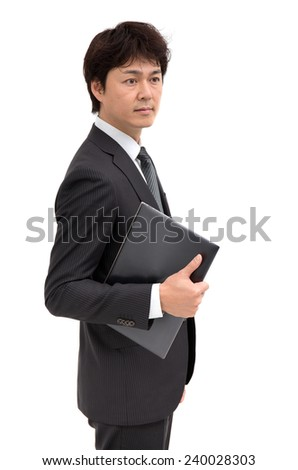 Businessman with a laptop computer - stock photo