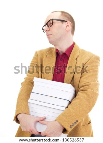 Businessman with a lot of books - stock photo