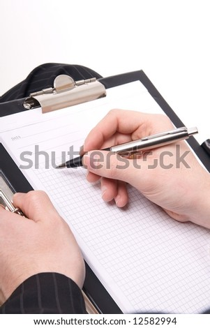 businessman with a pen - stock photo