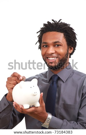 Businessman with a piggy bank - stock photo