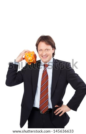 Businessman with a piggy bank on his shoulder - stock photo