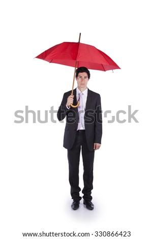 Businessman with a red umbrella - stock photo