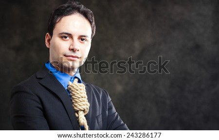 Businessman with a rope in place of a collar, tax pressure concept  - stock photo
