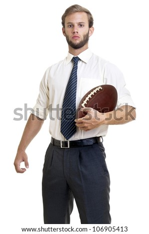 Businessman with a rugby ball - stock photo