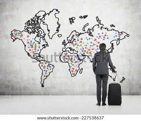 Businessman with a suitcase is standing infant of sketch of the world.  - stock photo