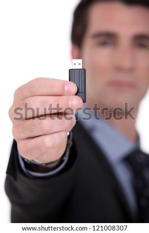 Businessman with a usb key - stock photo