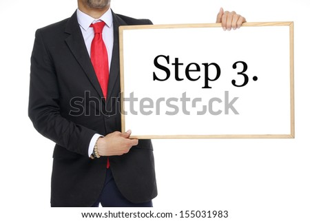 Businessman with a white board step 3. - stock photo