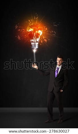 Businessman with an explosion bulb on black background - stock photo