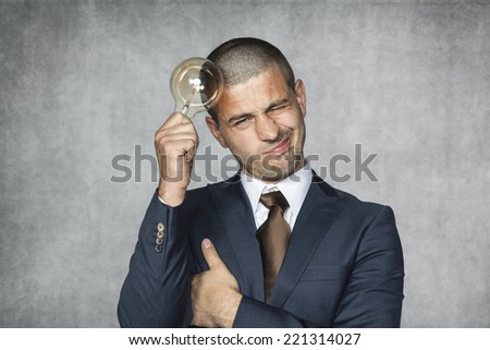 businessman with an idea for saving - stock photo