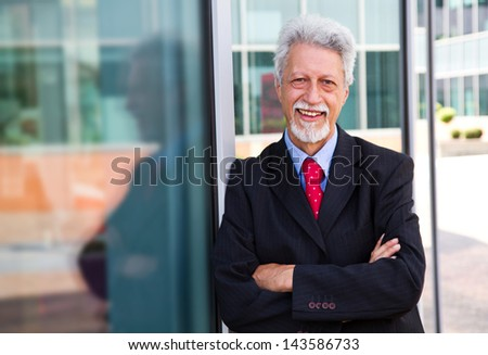 businessman  with an office building - stock photo
