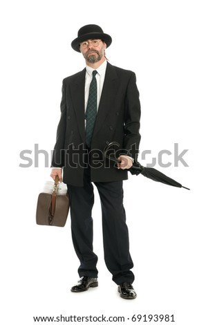 Businessman with an old bag and umbrella - stock photo