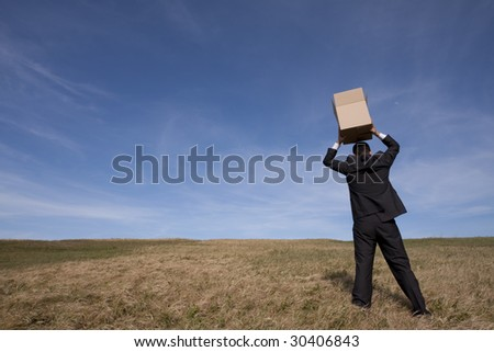 businessman with an open box at the field - stock photo