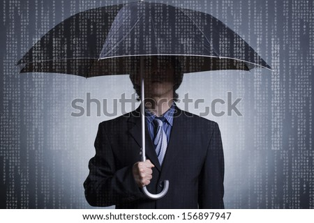 Businessman with an umbrella under digital rain. - stock photo