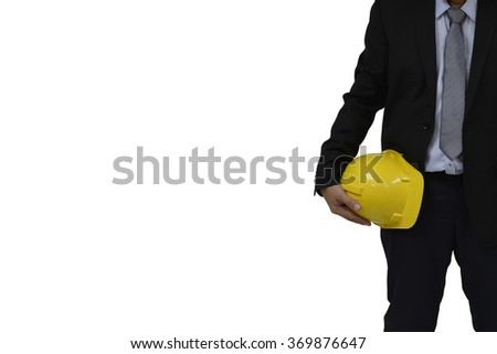Businessman with an yellow hat isolated on white. - stock photo