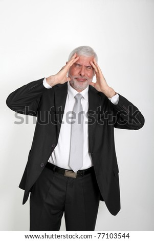 Businessman with annoyed look on his face - stock photo