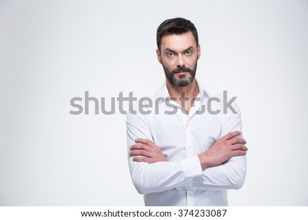 Businessman with arms folded looking at camera isolated on a white background - stock photo