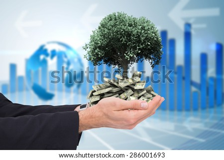 Businessman with arms out presenting something against global business graphic in blue - stock photo