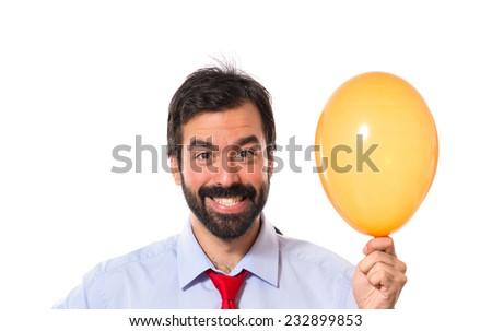 Businessman with balloon - stock photo