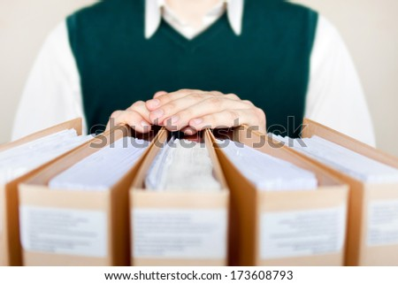 Businessman with binders at office. - stock photo