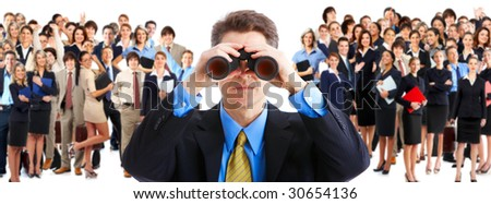businessman  with binoculars looking at the business people - stock photo
