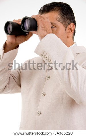 Businessman with binoculars looking to the future - stock photo