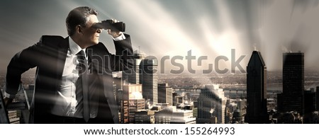 Businessman with binoculars. Search concept. - stock photo