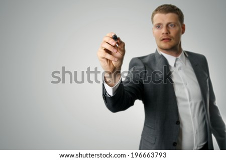 businessman with black marker in the hand - stock photo