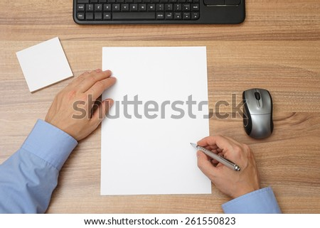 Businessman  with blank paper and pen in hand  to begin with writing. top view - stock photo
