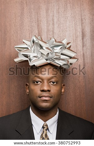 Businessman with bow on his head - stock photo