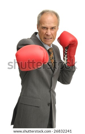 Businessman with boxing gloves isolated in white - stock photo