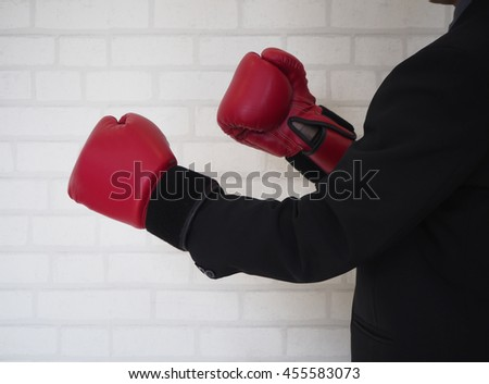 Businessman with boxing gloves ready to fight, business fight concept - stock photo