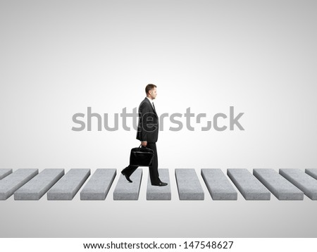 businessman with briefcase on a white background - stock photo