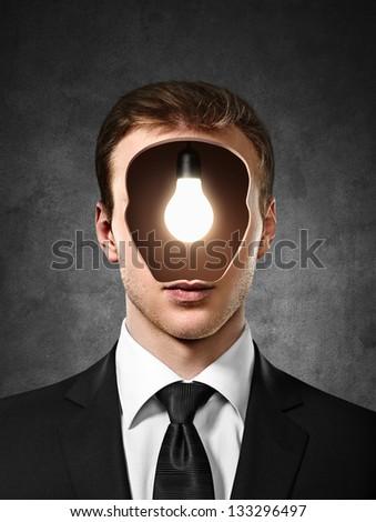 businessman with bulb inside head - stock photo