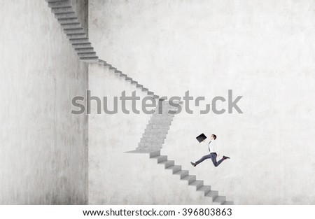Businessman with case running up steep stairs. Concrete background. Concept of career growth. - stock photo