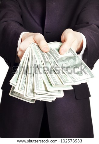 Businessman with cash - stock photo