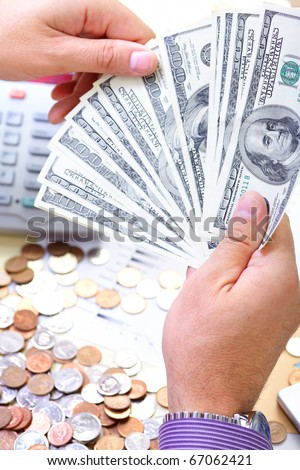 Businessman with cash, money, bills, coins - stock photo