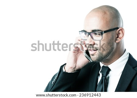 Businessman with cell phone isolated on white - stock photo