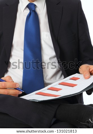 Businessman with chart on his lap - stock photo