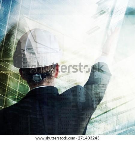 Businessman with construction helmet - stock photo