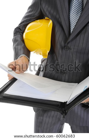 Businessman with construction helmet. Isolated on white background - stock photo